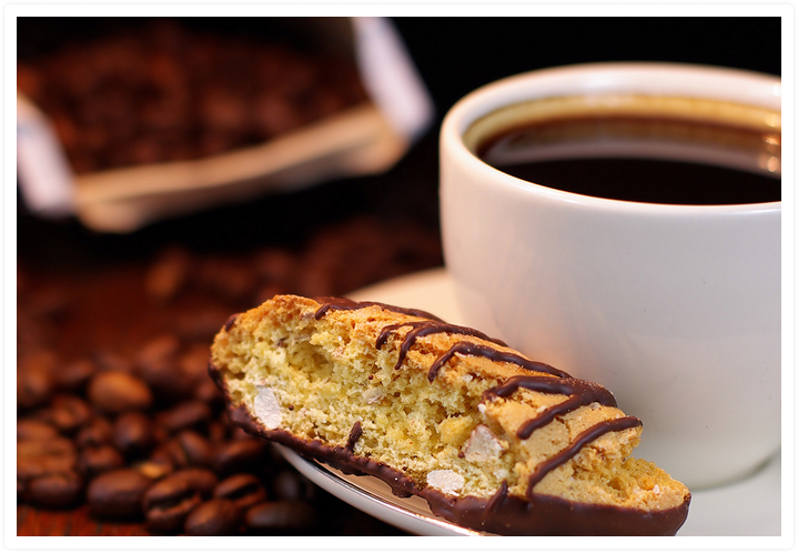 Cup of Kona Coffee with biscotti